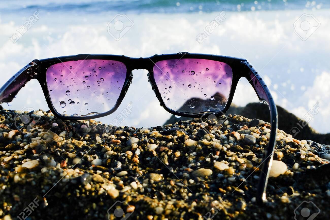 Black sunglasses at sea background - 122488830