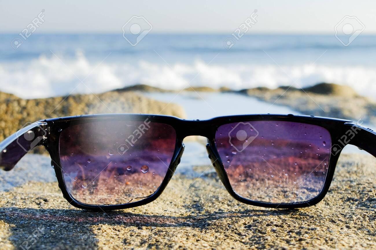 Sunglasses at sea background - 122488834