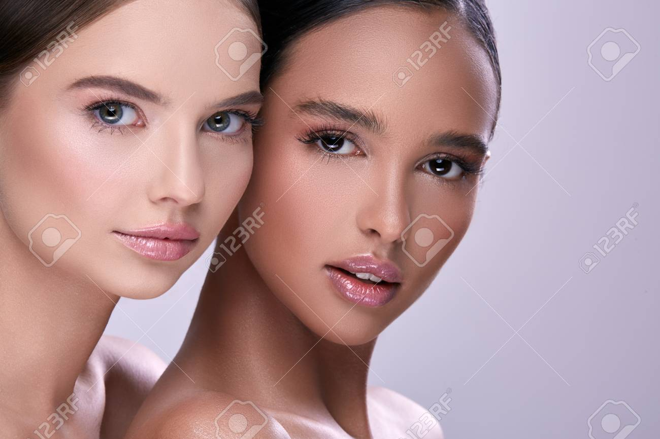 close-up portait of two beautiful woman - 122186947