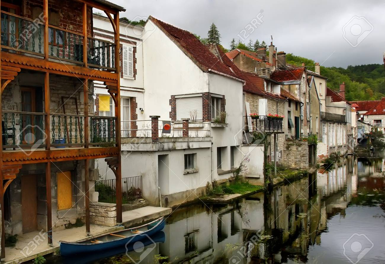 View from a bridge over a canal in the medieval town of Tonnerre, France - 11890632