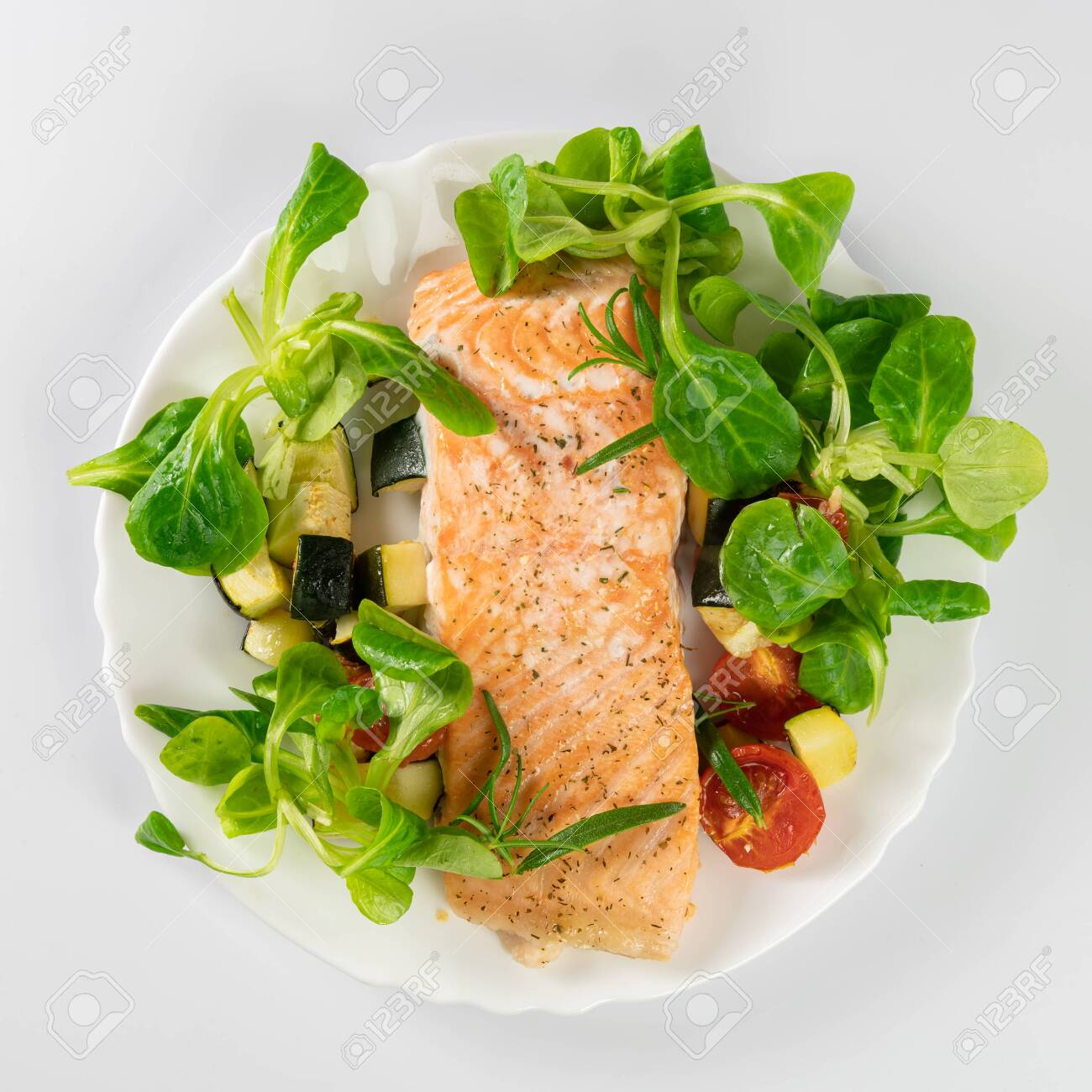 Delicious roasted fish served on white plate - 135181506