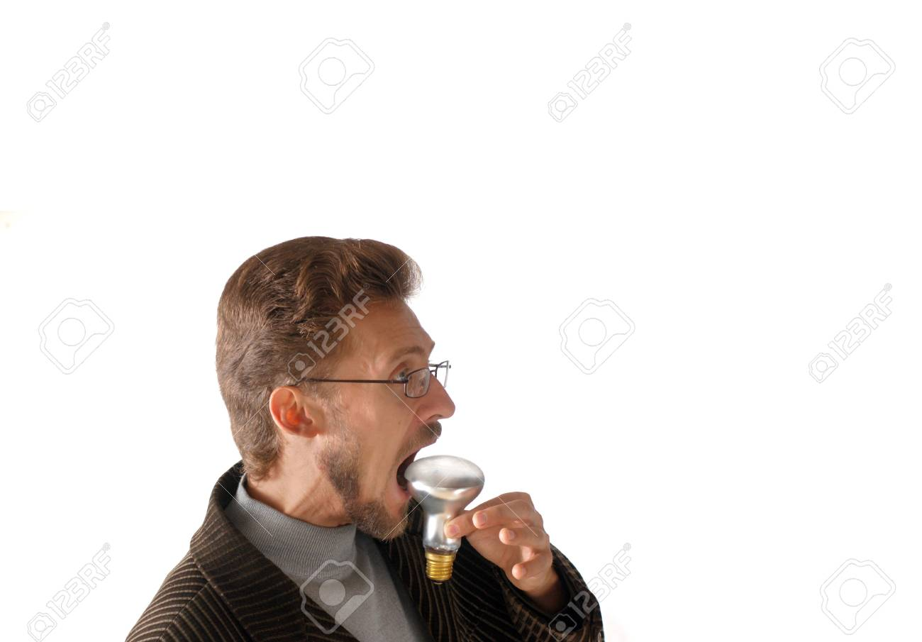 Businessman eating an electric lamp Stock Photo - 2346264