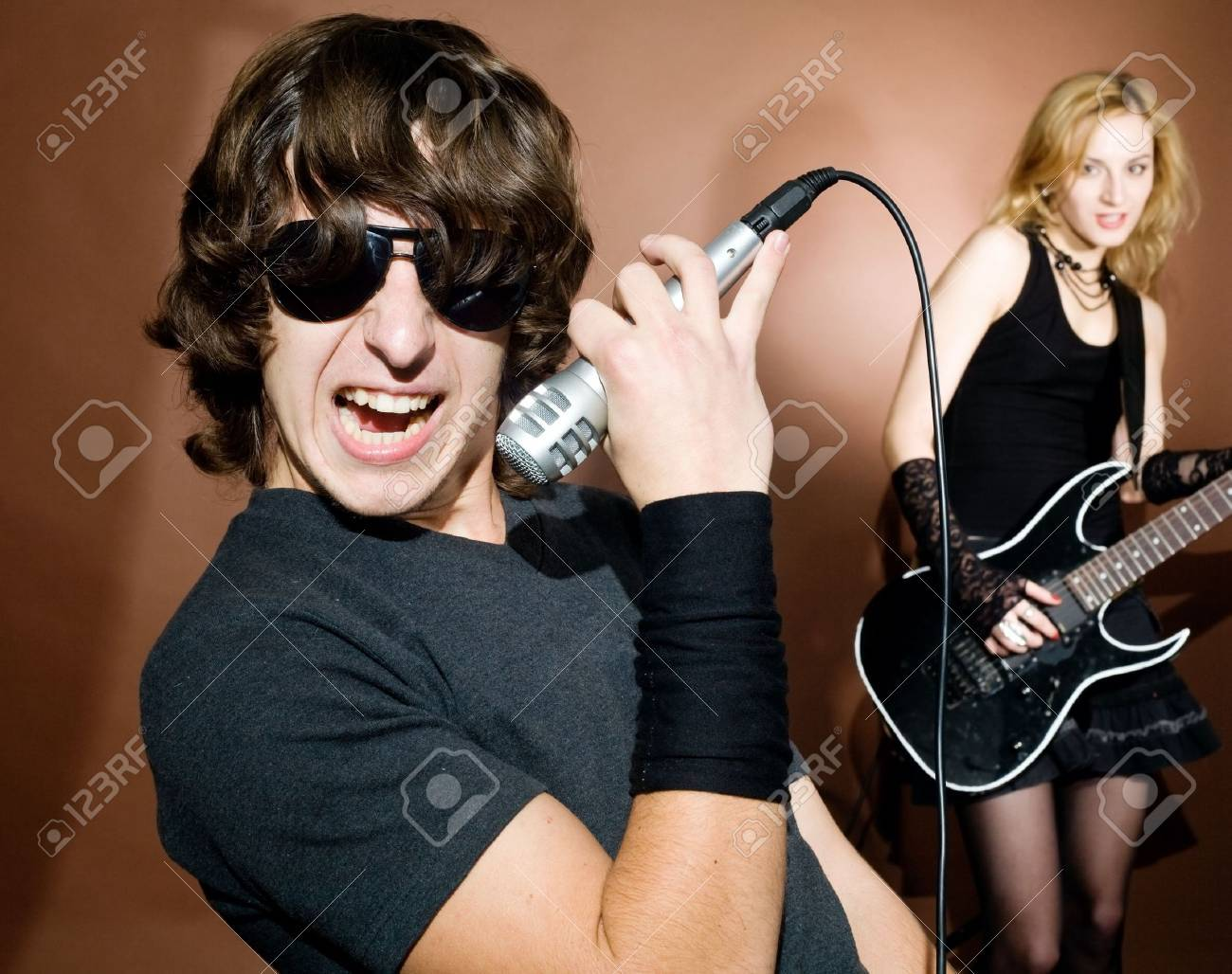 Rock singer with woman during in studio. Stock Photo - 5941848
