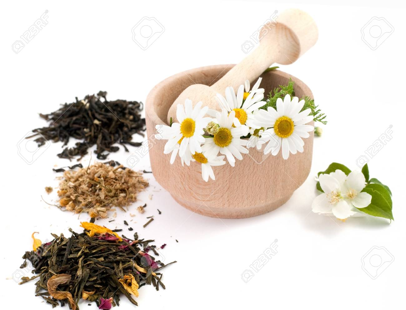 An image of wooden mortar with flowers in it and tea Stock Photo - 7284836