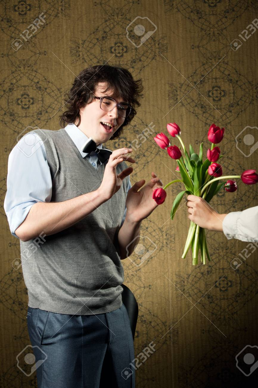 An image of a man in big glasses and red flowers Stock Photo - 8271447