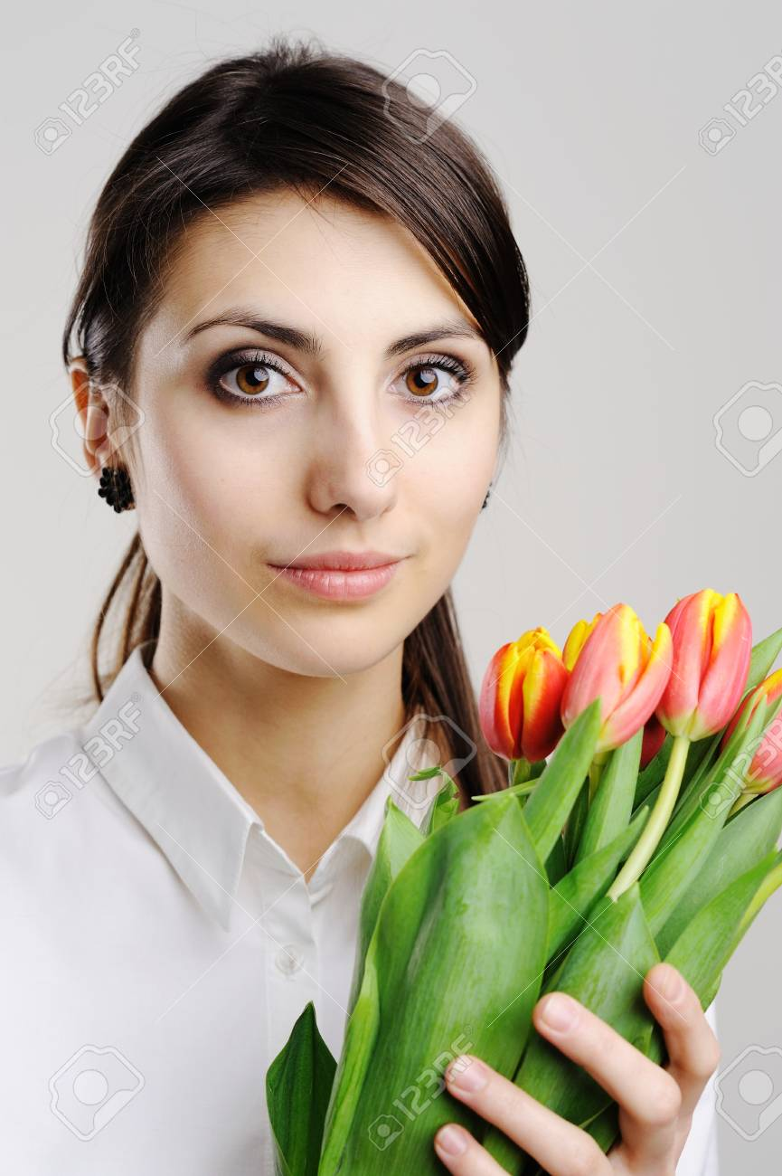 An image of young businesswoman with tulips Stock Photo - 8761629