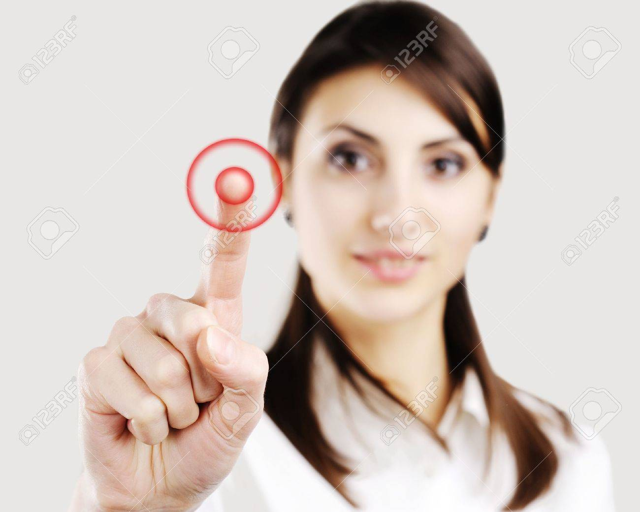 Young business woman pointing at something on screen Stock Photo - 8983316