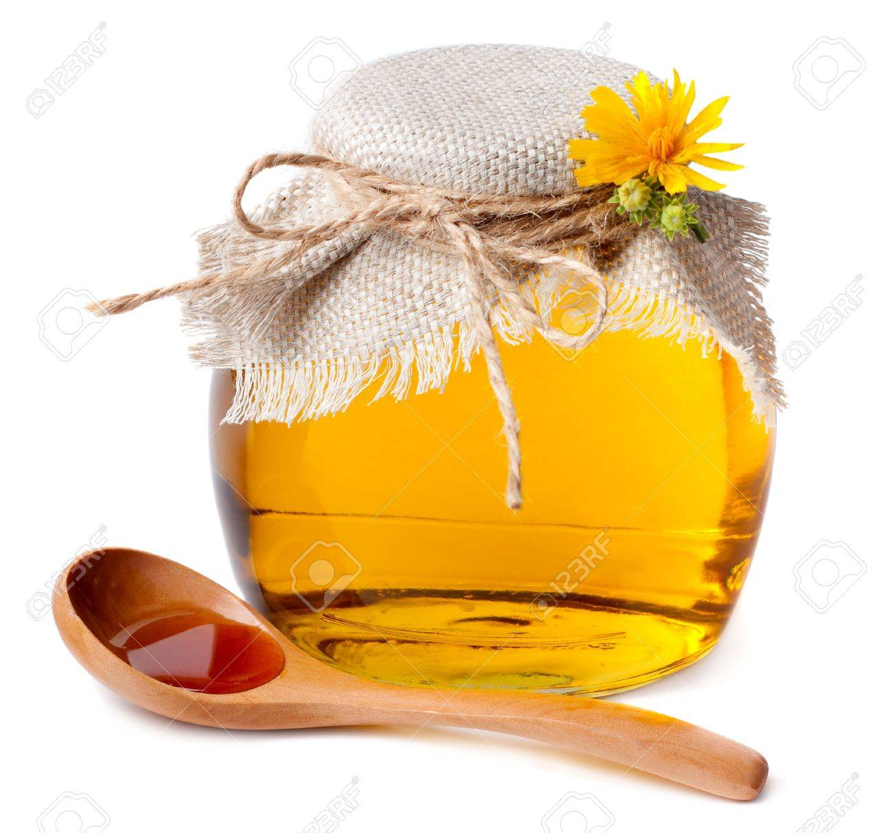 Honey in the pot and a wooden spoon Stock Photo - 14974814
