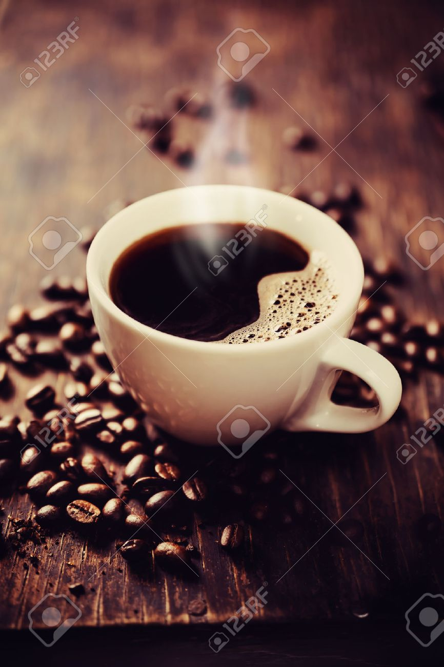 Steaming cup of freshly brewed coffee. Shallow depth of field Stock Photo - 25127110