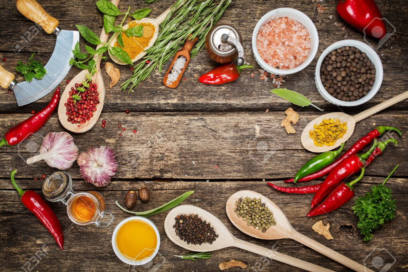 Various spices and herbs with copyspace, pink pepper, Himalayan salt, garlic and olive oil Stock Photo - 44245395