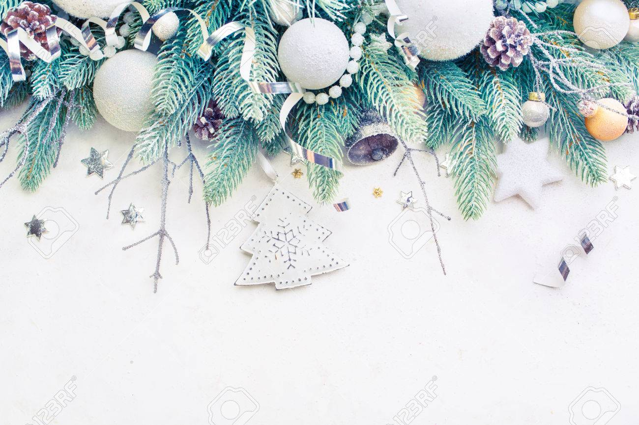 Christmas Holiday Background.Christmas Tree Pine Branches And Christmas Balls On A Light Background