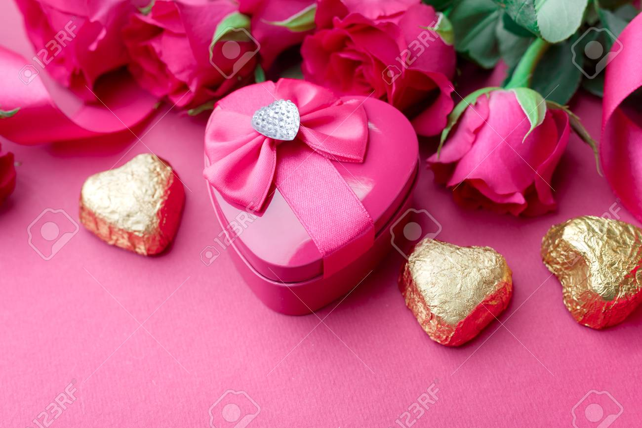 Heart Shaped Valentines Day Gift Box With Pink Roses And Candy Stock ...