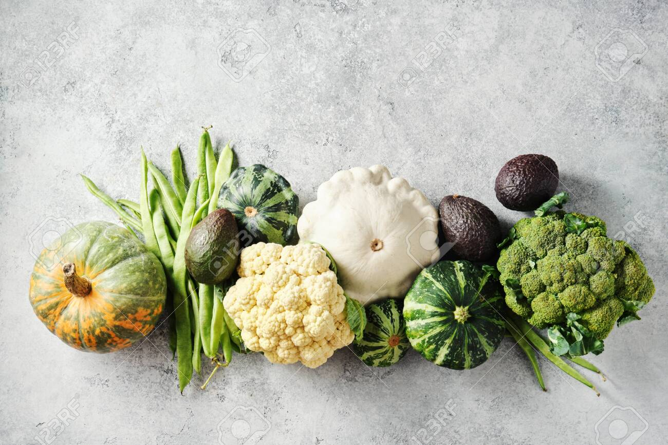 Broccoli, cauliflower, green beans, squash, and other fresh on a grey background. - 130028351