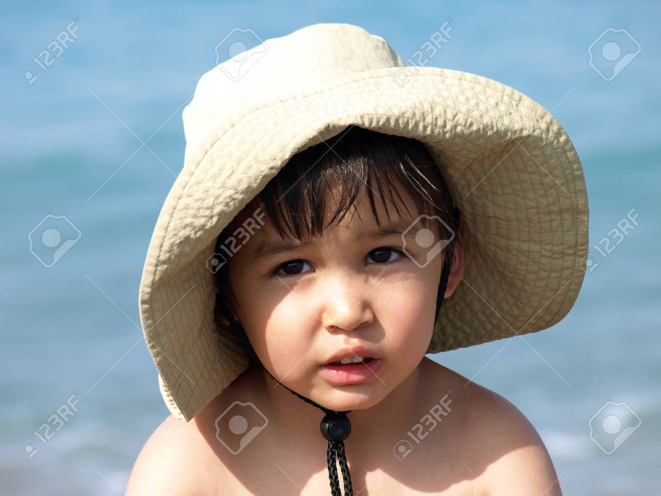 Little boy in hat on the beach Stock Photo - 3231985