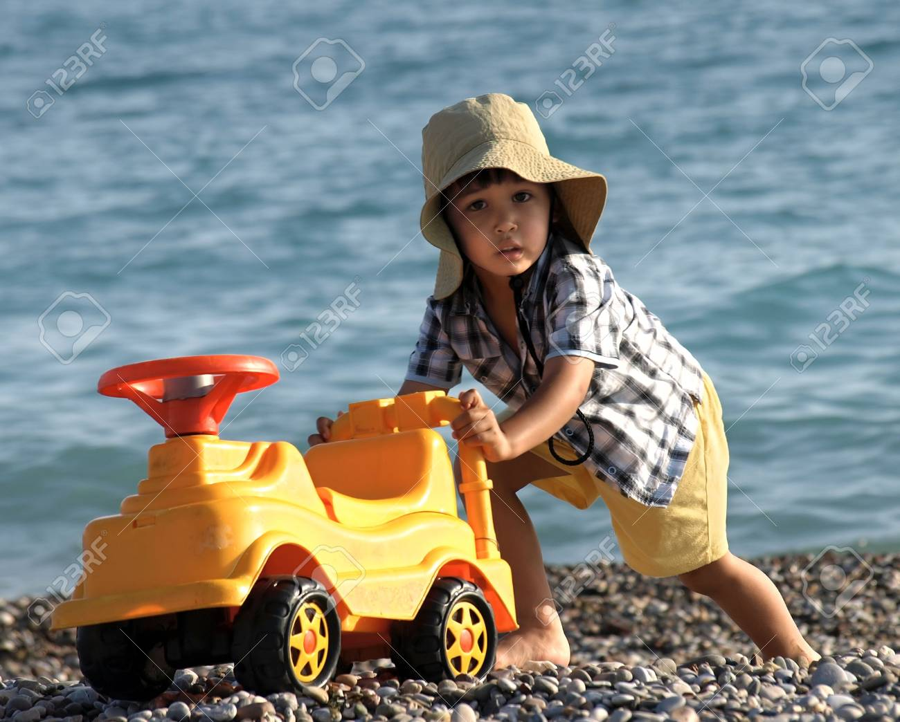 Fun little boy playing with  on the beach Stock Photo - 3231986