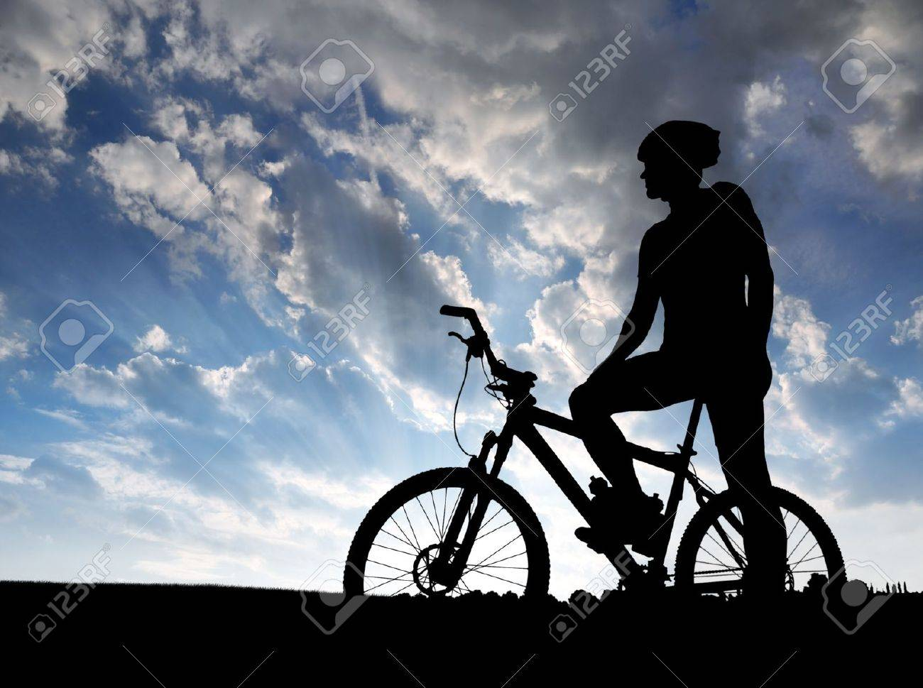 mountain biker silhouette in sunrise stock photo 11498897