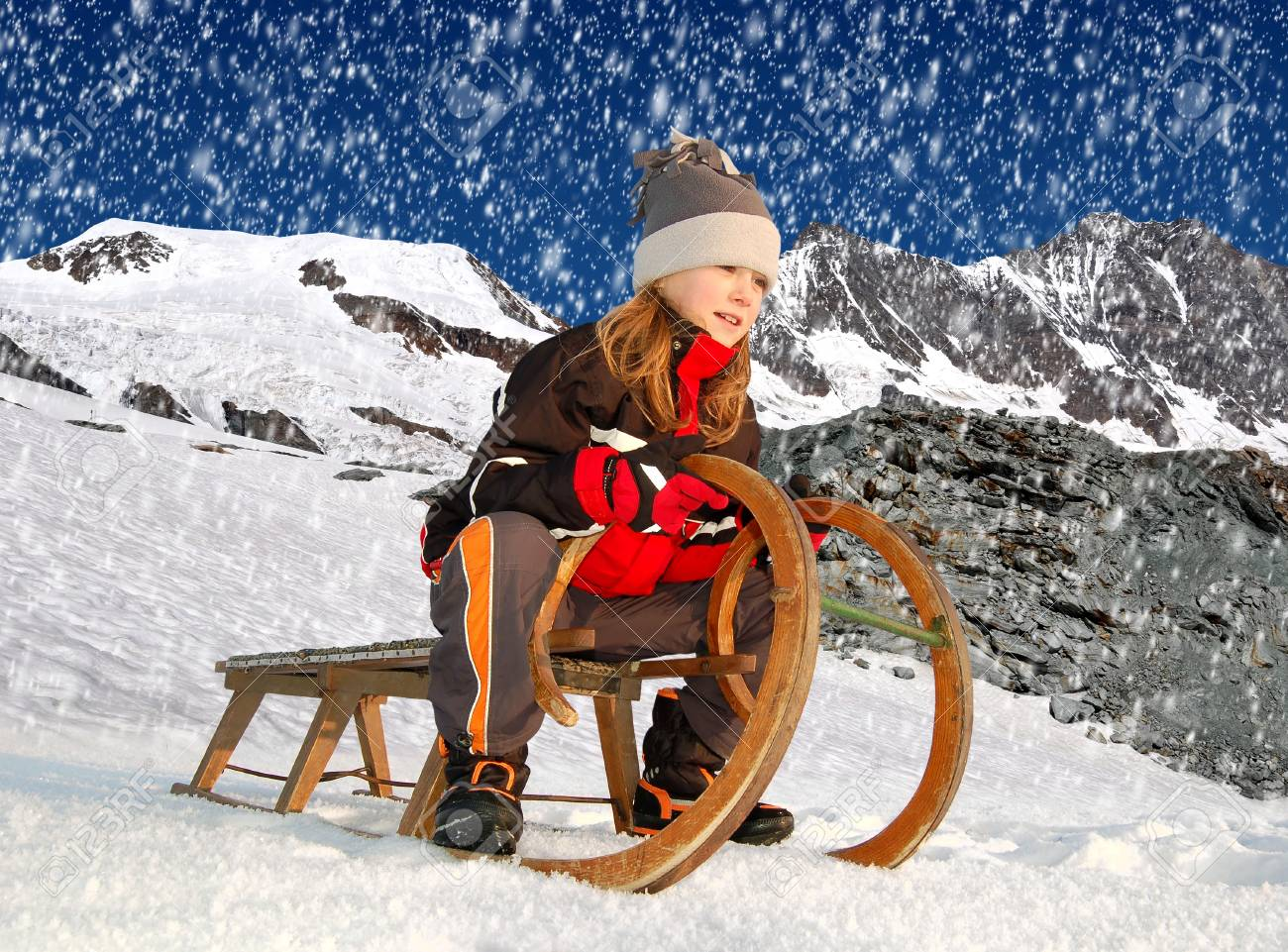 girl on a sleigh Stock Photo - 17079311