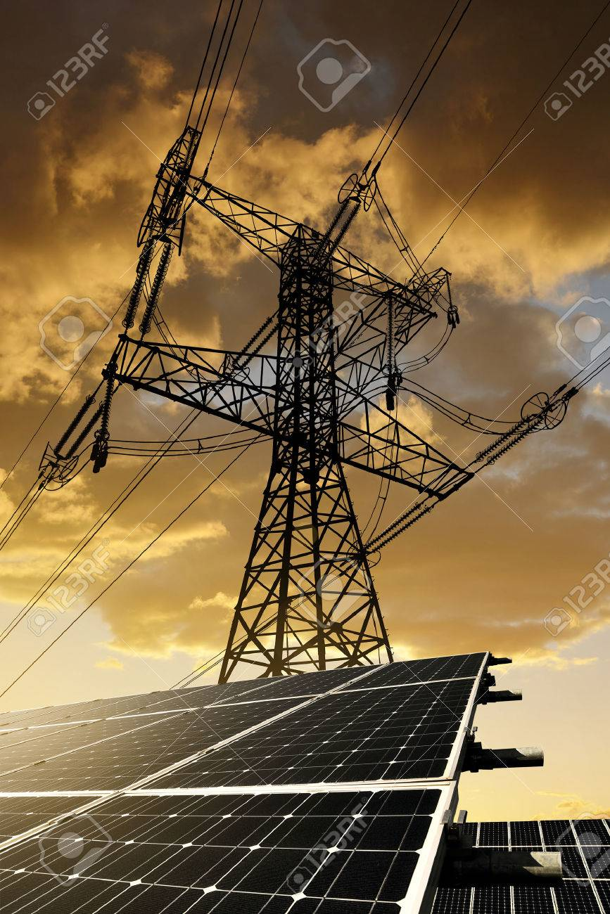 Solar panels with electricity pylon at sunset. Clean energy concept. - 47183936