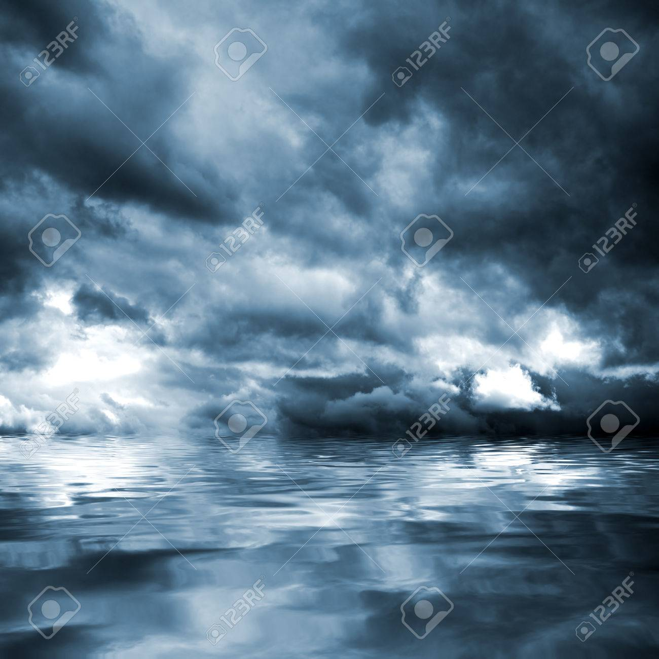 Dark storm clouds before rain above the water level. Natural background. - 46298295