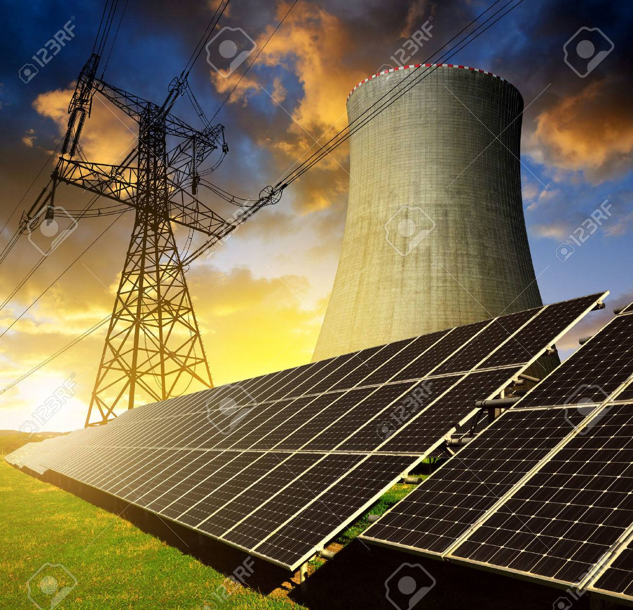 Solar energy panels, nuclear power plant and electricity pylon at sunset - 47993564