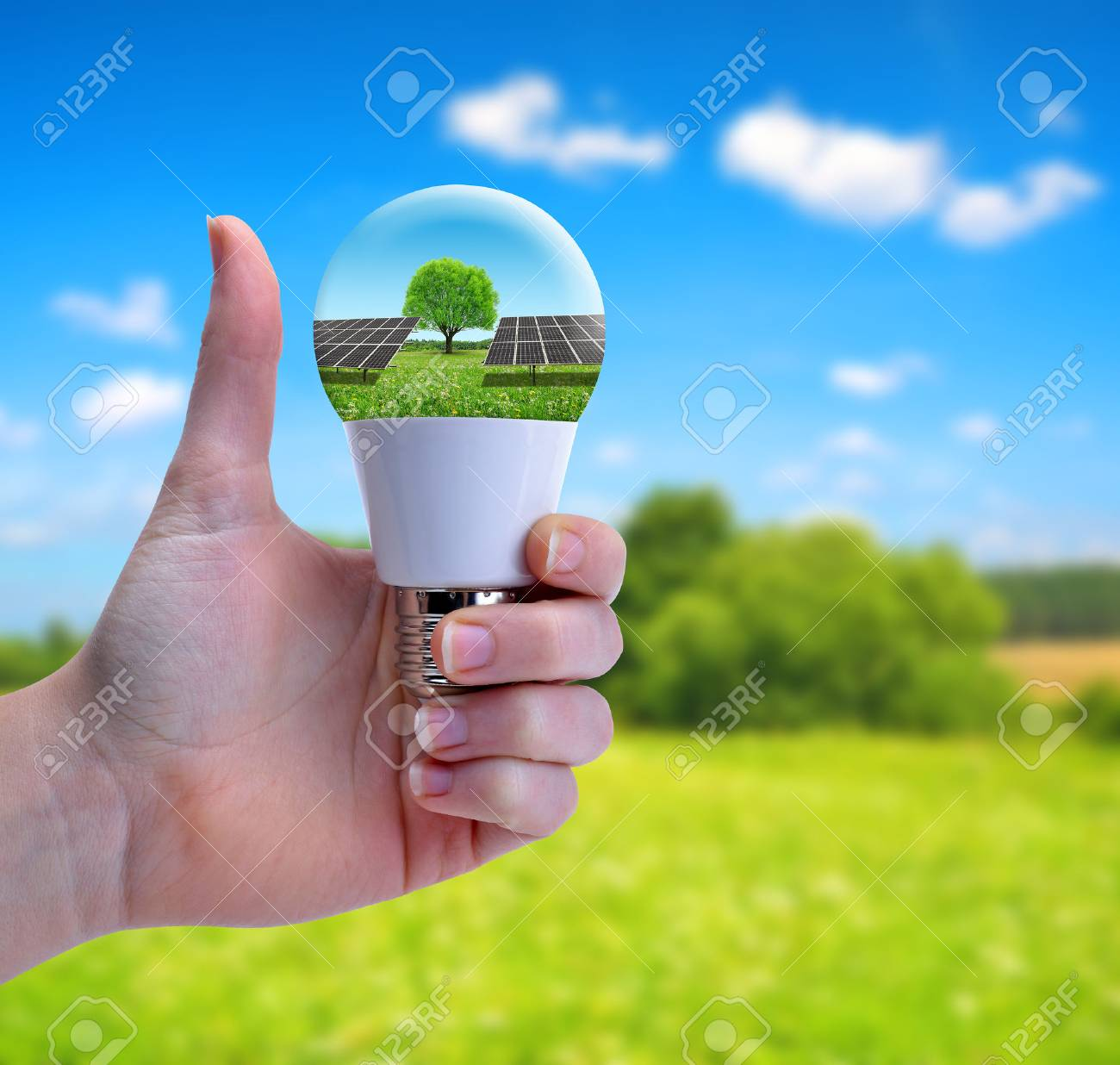 Hand with thumb up holding a eco LED bulb with solar panel. The concept of sustainable resources. - 71691480