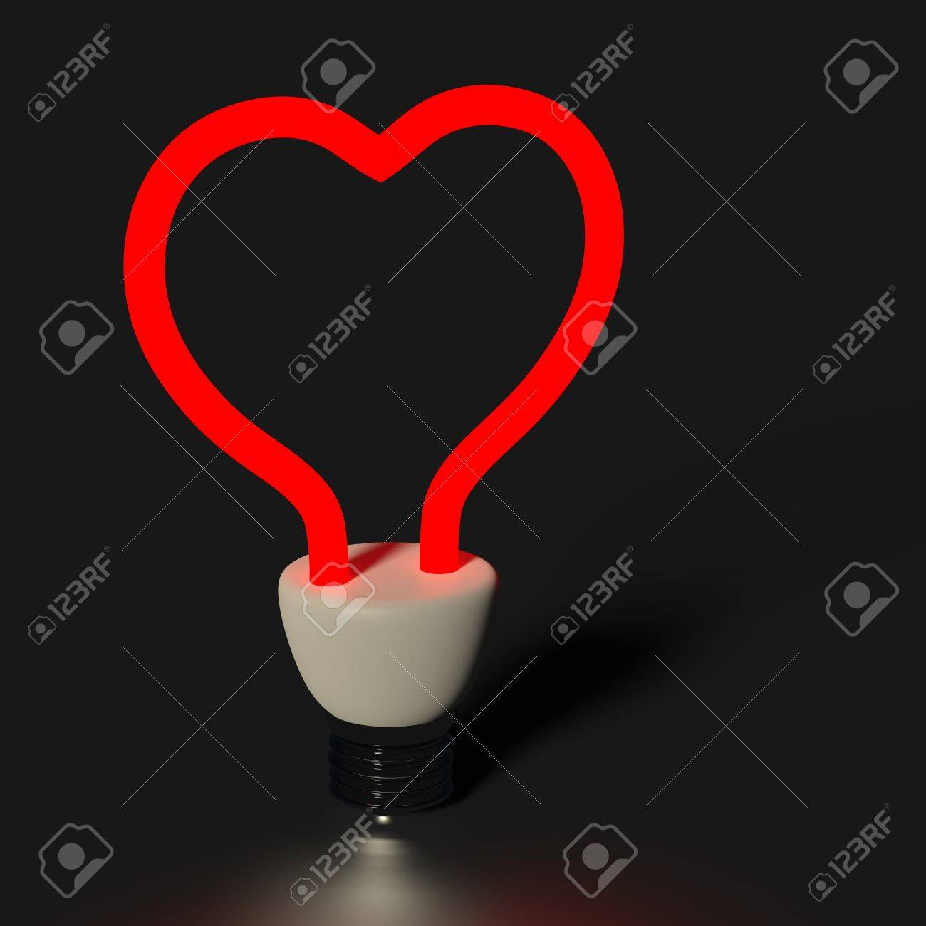 Red heart shaped light bulb isolated on black Stock Photo - 12989923