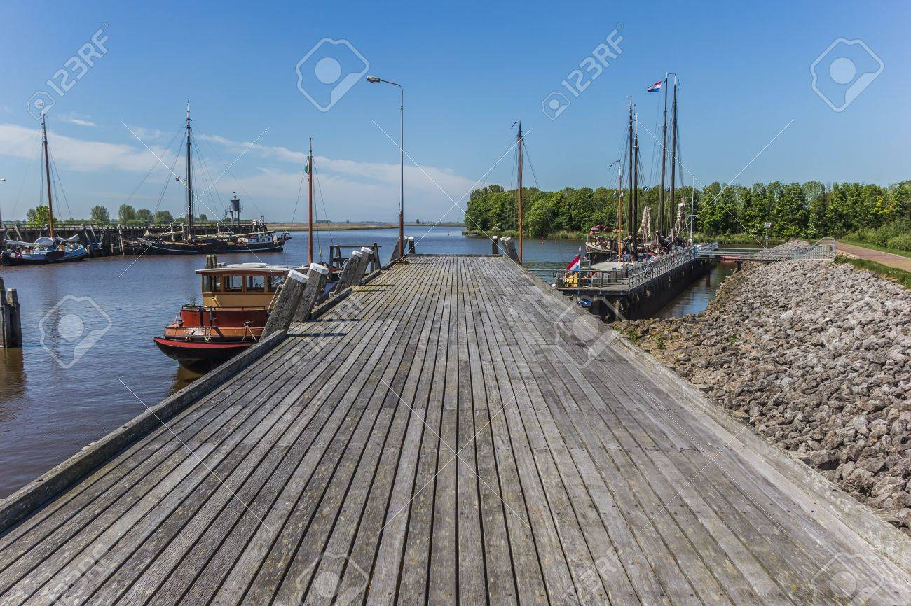 Wooden jetty in the harbor of Zoutkamp Stock Photo - 20407560