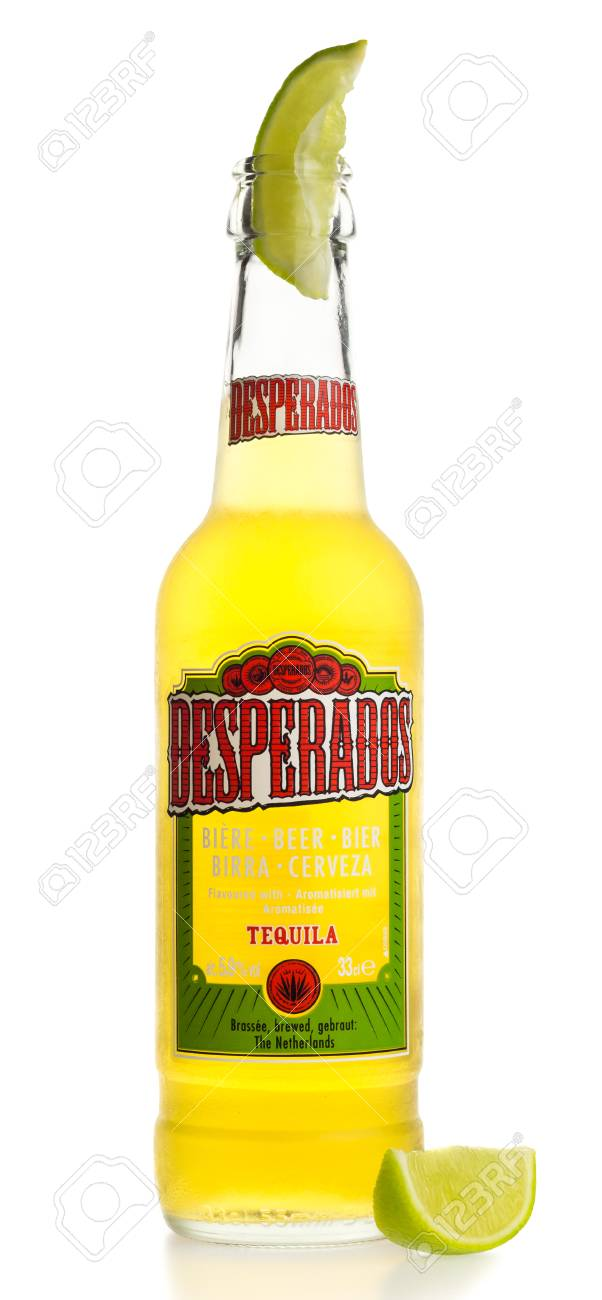 Bottle Of Mexican Desperados Tequila Beer With Lime Wedge Isolated Stock Photo Picture And Royalty Free Image Image 73662930