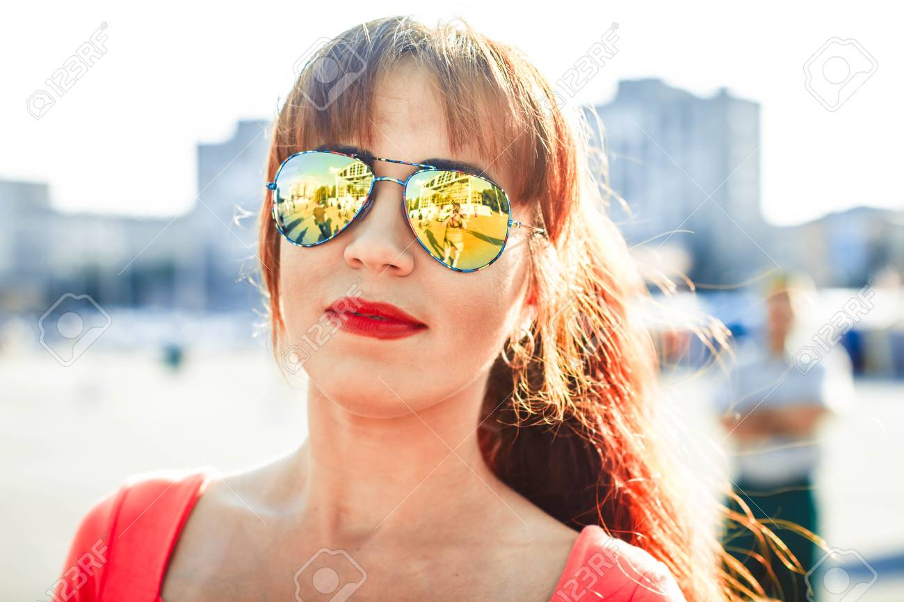 38cf1aee0b949 Closeup selfie-portrait student of attractive girl in sunglasses with long  hairstyle and snow-