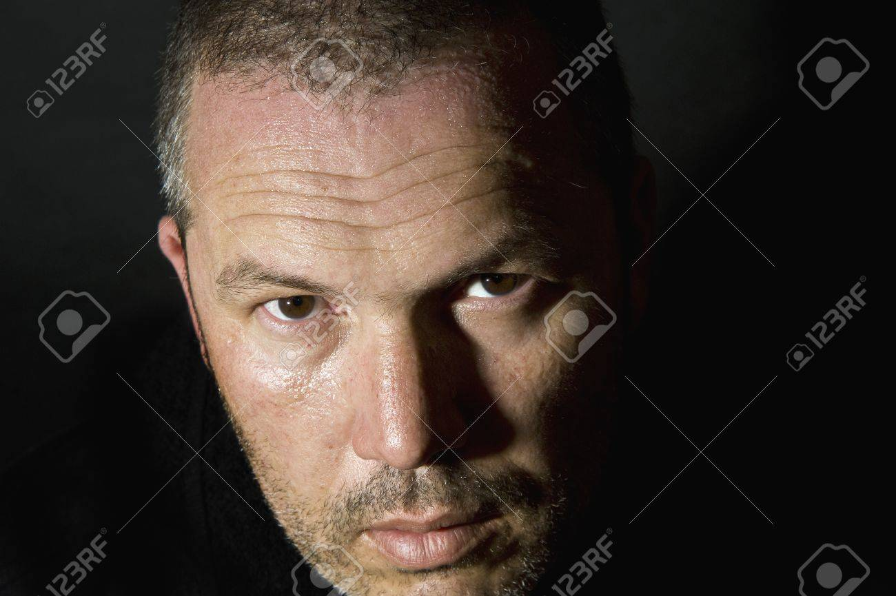 Dark and moody portrait of serious looking male adult Stock Photo - 8795283