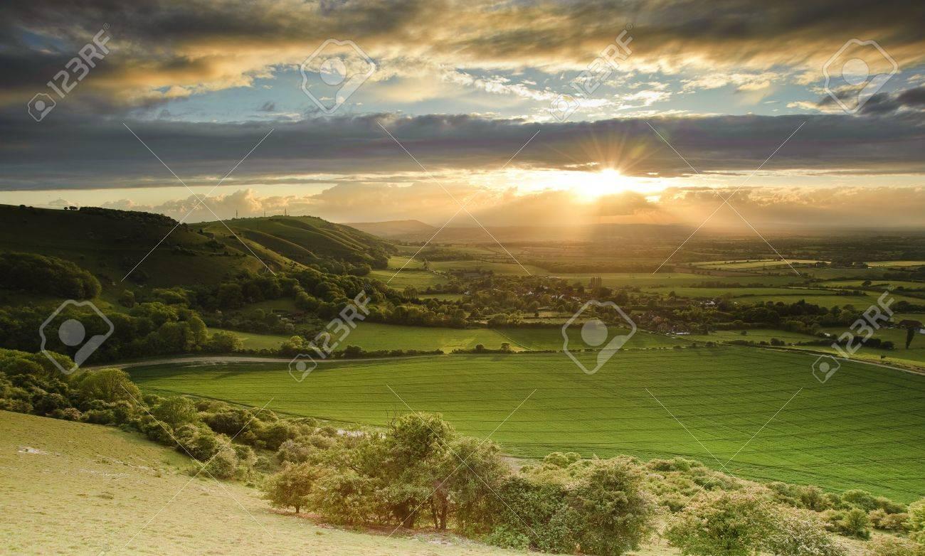 Landscape over English countryside landscape in Summer sunset - 9603437