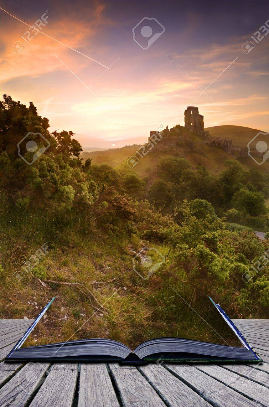 Beautiful dreamy fairytale castle ruins against romantic colorful sunrise coming out of pages in magical book creative concept Stock Photo - 9940692