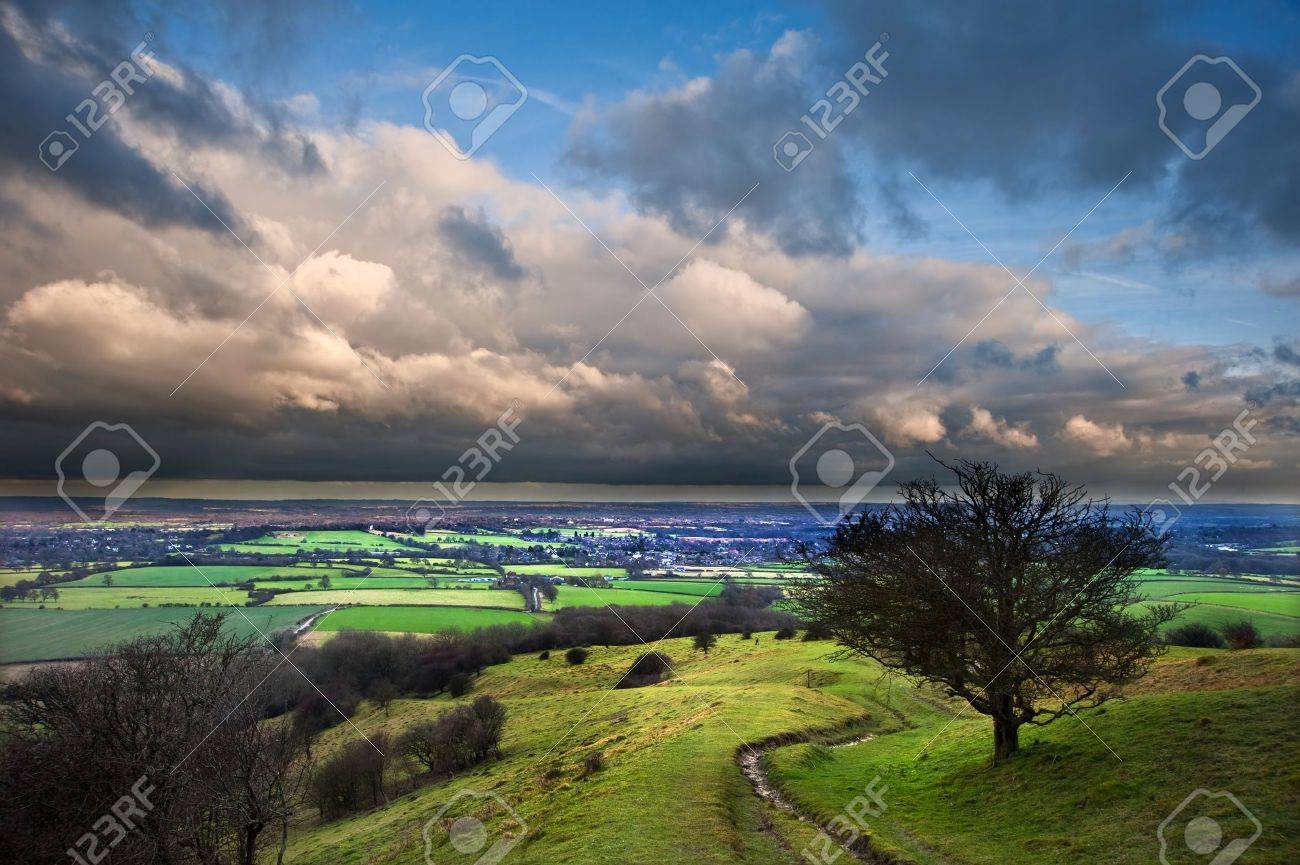 Stunning cloud formations during stormy sky over countryside landscape with vibrant colors Stock Photo - 12324089