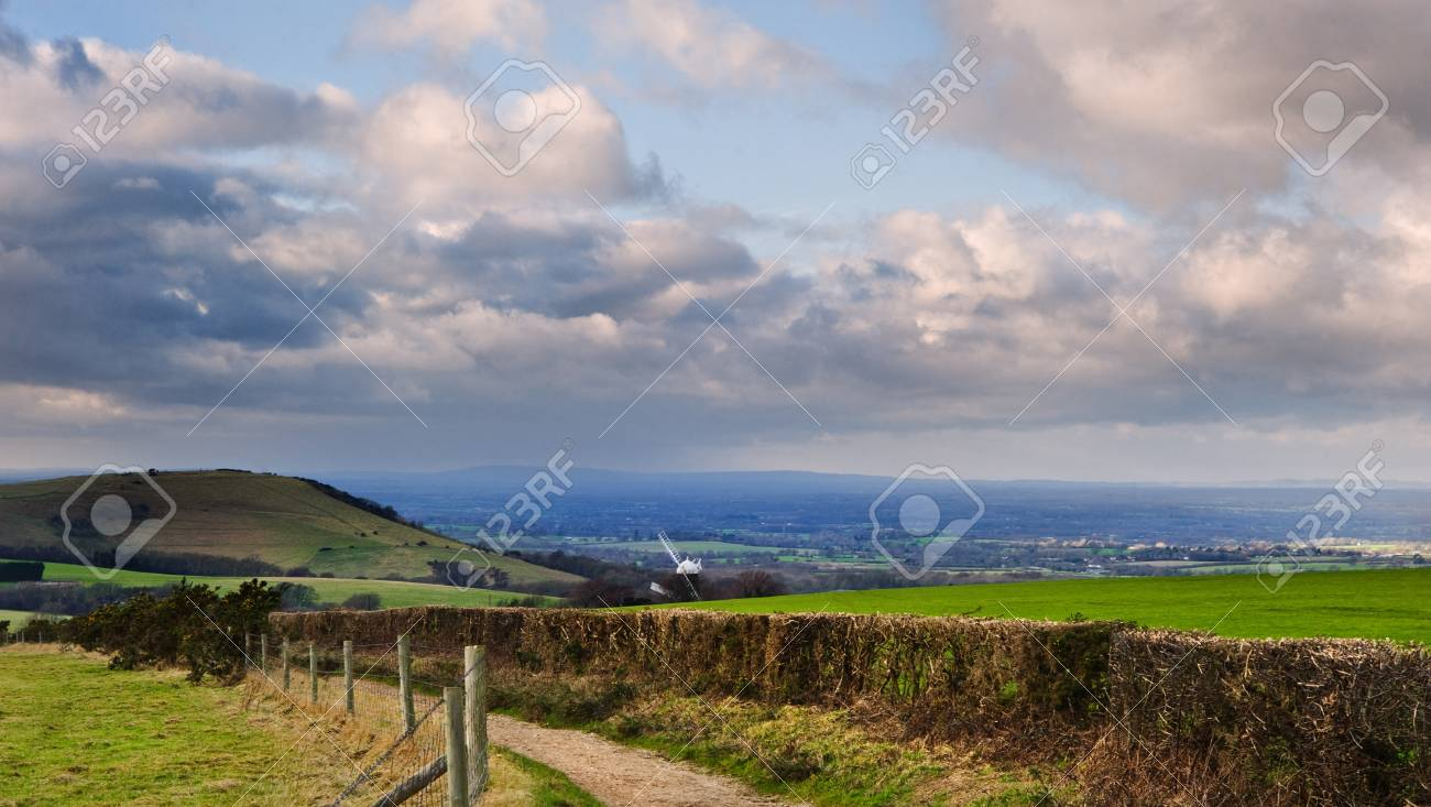 Stunning moody sky with beautiful cloud formations and colors over countryside landscape of path leading into distance Stock Photo - 12324128
