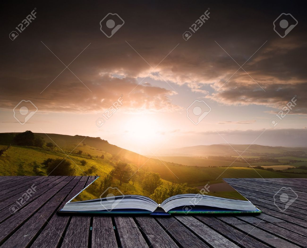 Creative composite image of Summer landscape in pages of magic book Stock Photo - 15521131