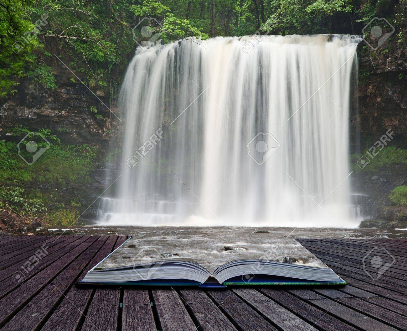 Creative composite image of waterfall in woods in pages of magic