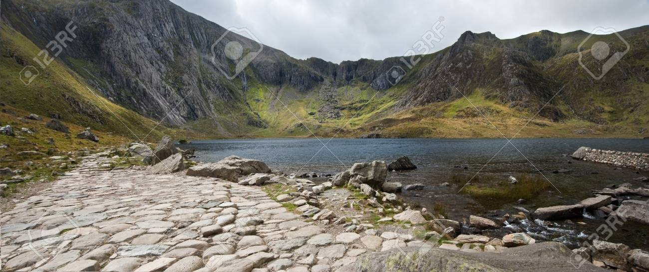View along footpath going round Llyn Idwal in Snowdonia National Park witth Devil's Kitchen in background Stock Photo - 15533615