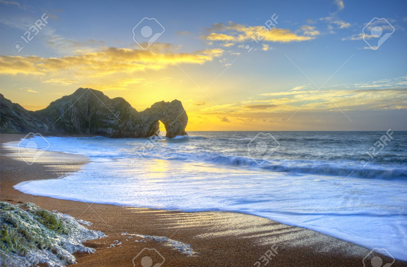 Beautiful sunrise over ocean with rock stack in foreground Stock Photo - 17387528