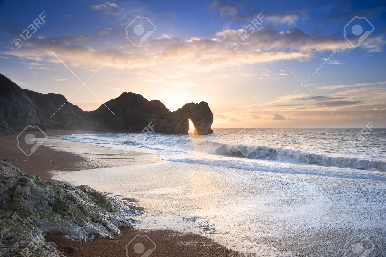 Beautiful sunrise over ocean with rock stack in foreground Stock Photo - 17559765