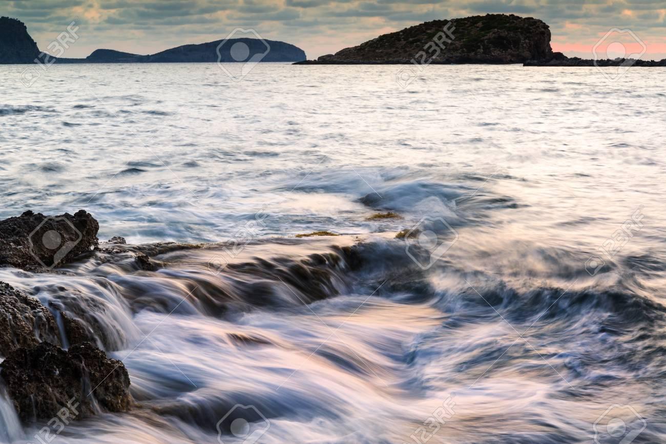 Dawn sunrise landscape over beautiful rocky coastline in Mediterranean Sea Stock Photo - 22577155