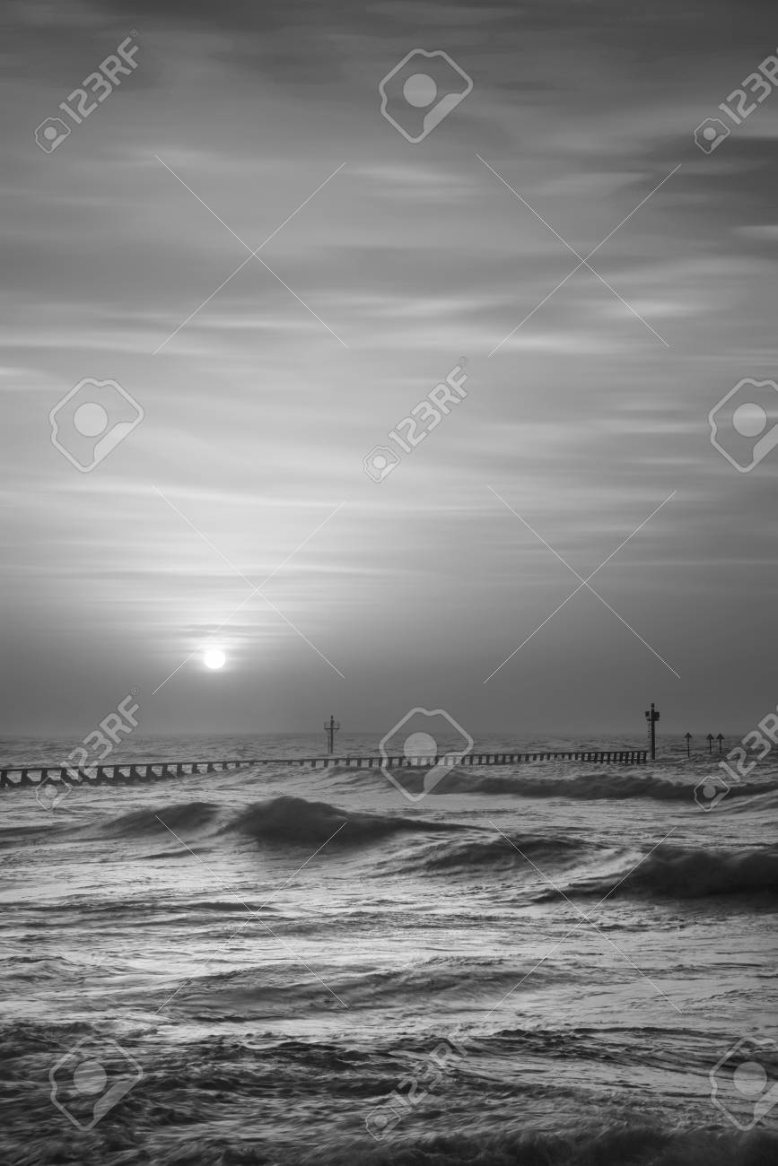 Beautiful moody black and white stormy landscape image of waves