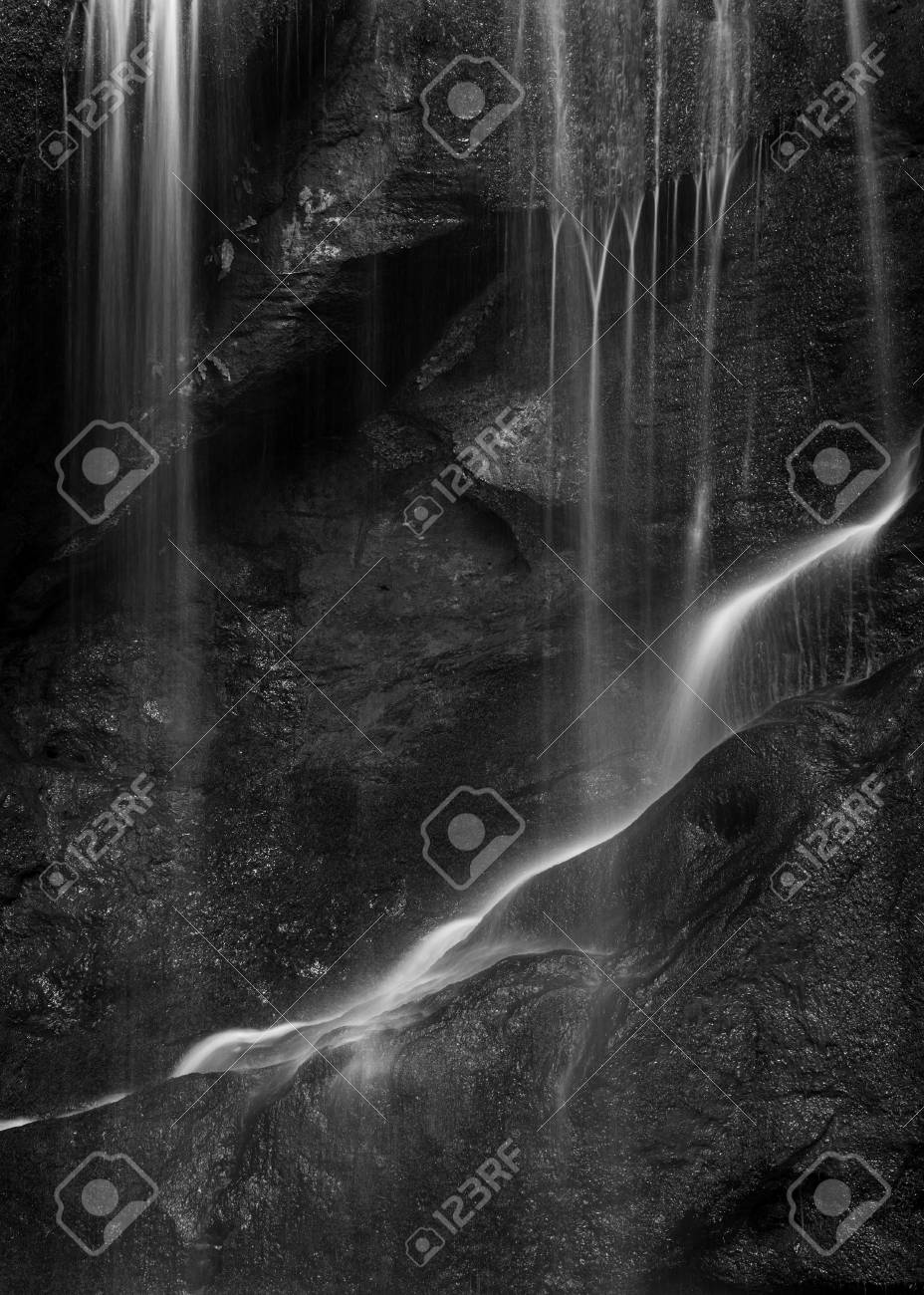 Stunning peaceful black and white long exposure waterfall detail