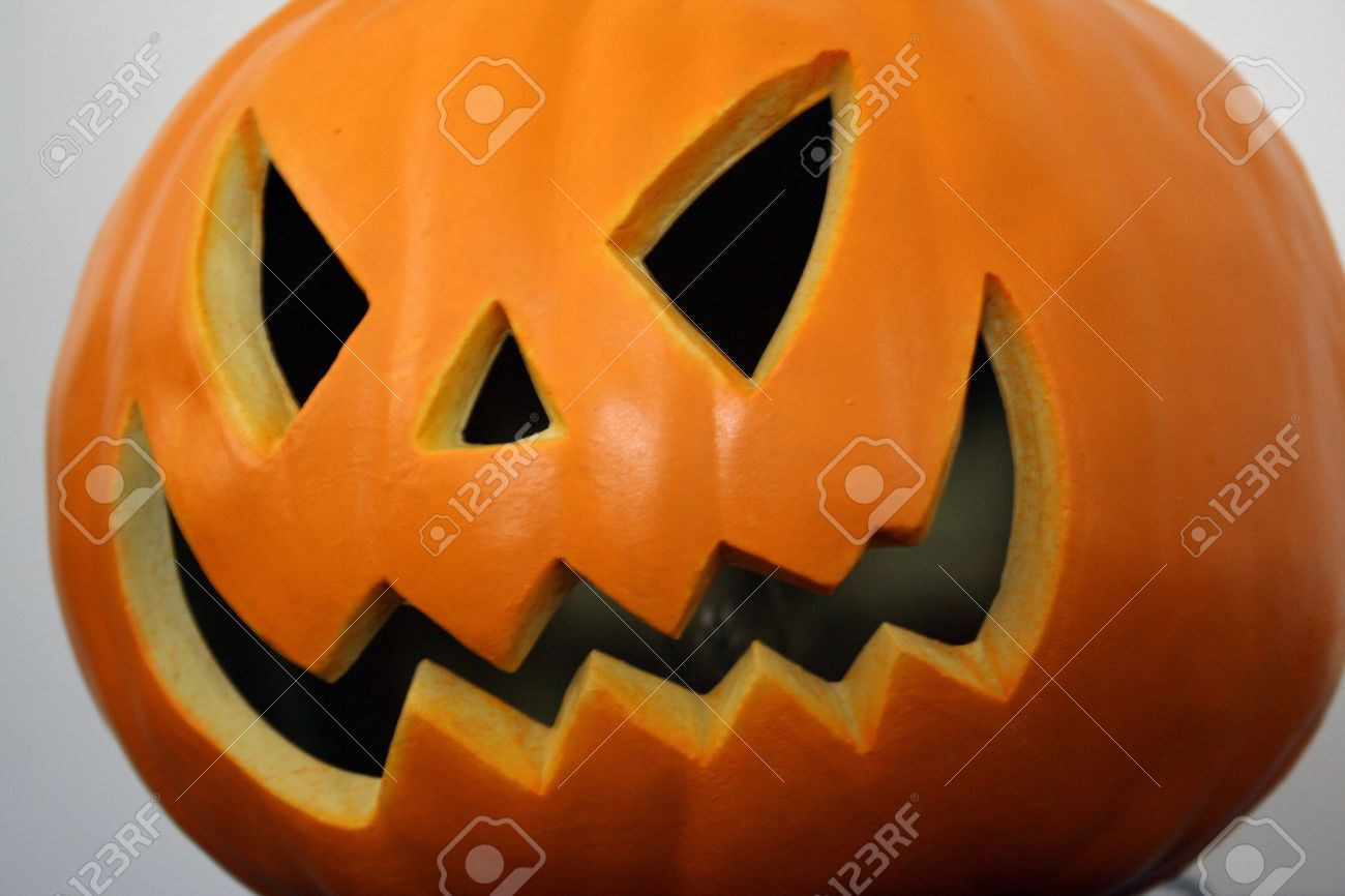 Scary Halloween Pumpkin Face Stock Photo   3678541