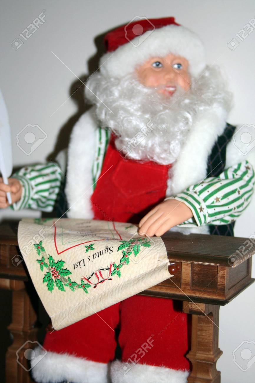 Miniature santa checking his list Stock Photo - 3972435
