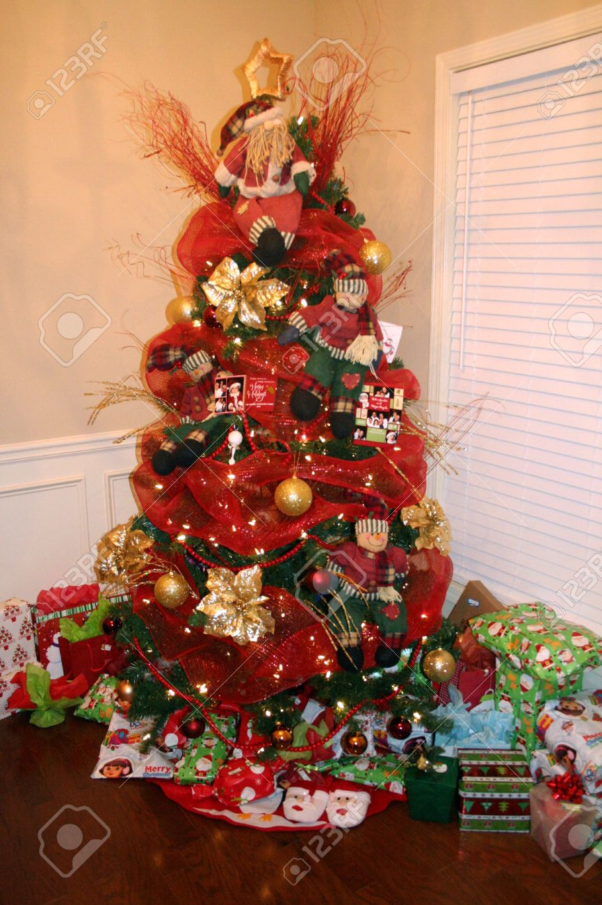 Red and gold christmas tree decorations - Stock Photo Christmas Tree Decorated With Red And Gold Ornaments