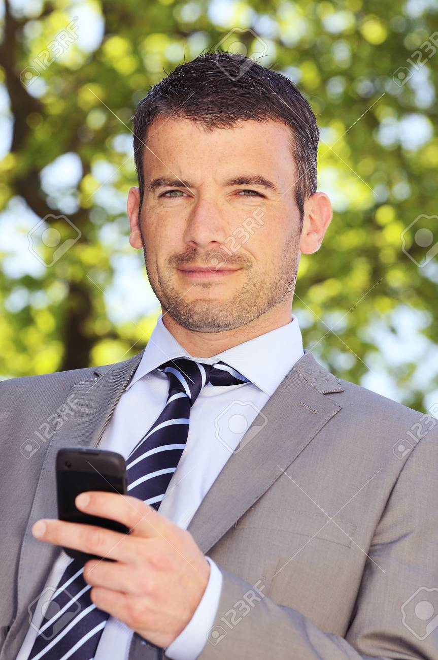 businessman is having a communication with his cellphone Stock Photo - 9530072