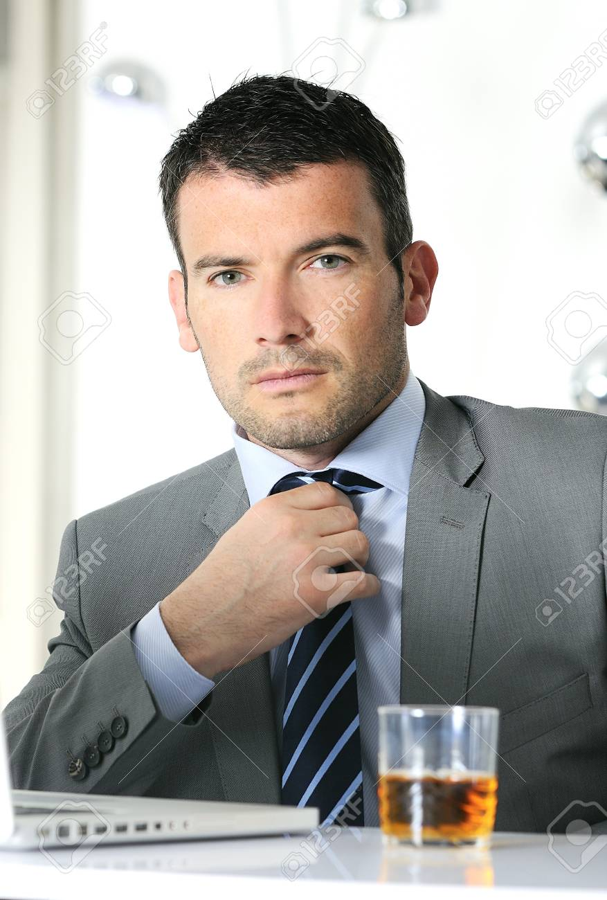 business man is drinking alchool at the office Stock Photo - 9530067