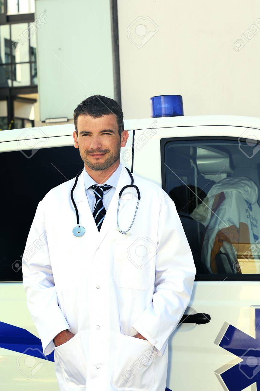 doctor is writing a report behind an ambulance Stock Photo - 9860490