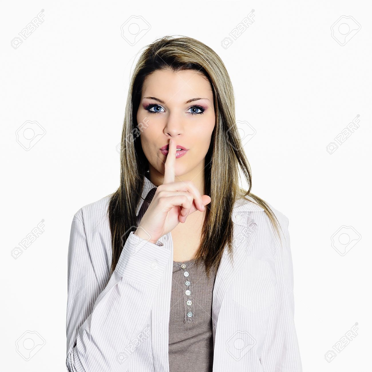 young woman seeking the silence with a finger on the mouth Stock Photo - 16521616