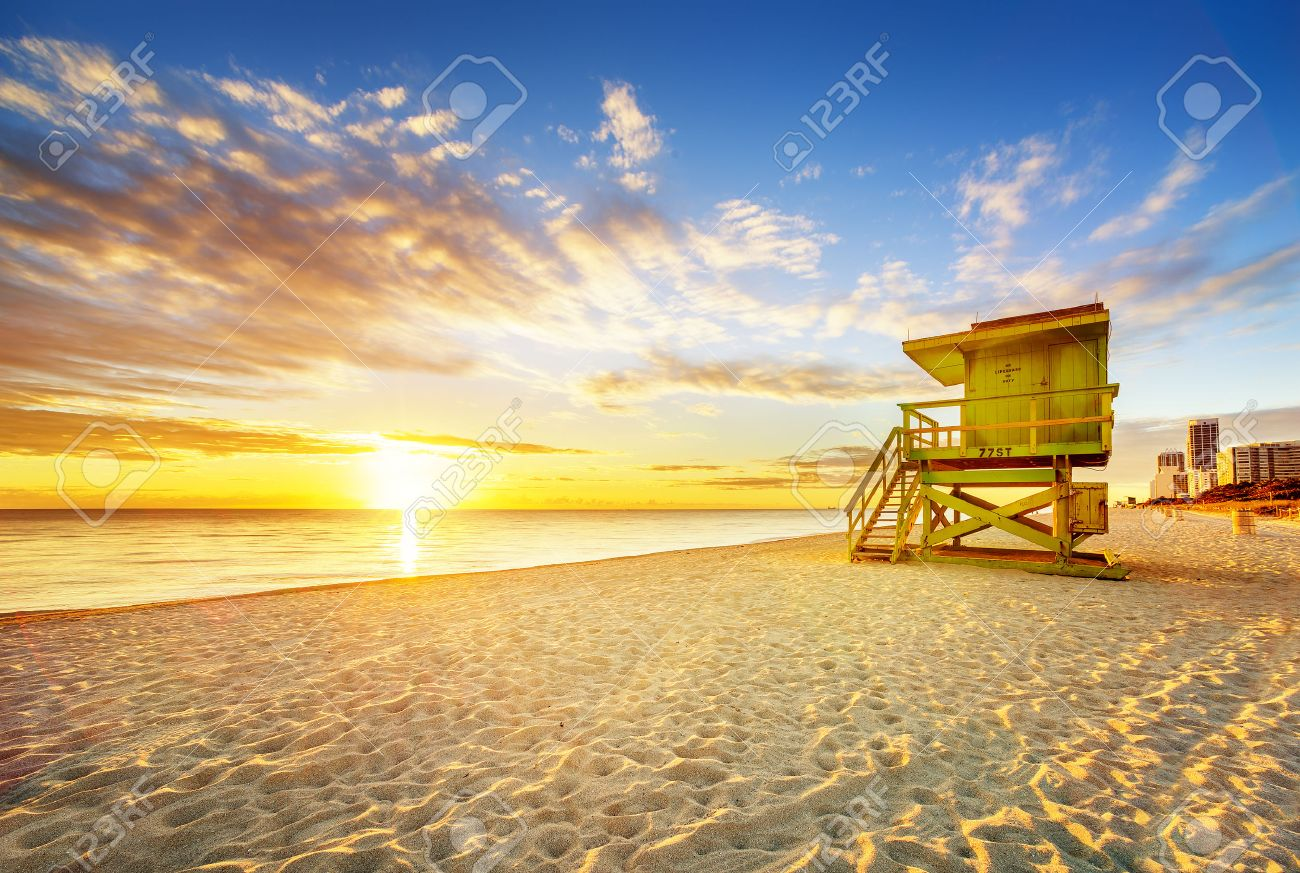 Miami South Beach sunrise with lifeguard tower and coastline with colorful cloud and blue sky. - 30178265